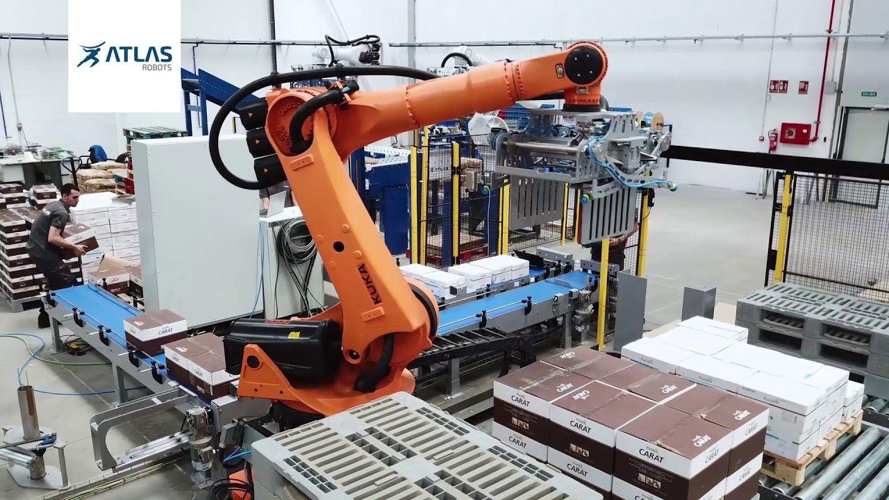 Robot paletizador de cajas con track movil